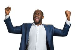 Handsome businessman emotionally shouting yes. Cheerful successful businessman with fists raised, satisfaction and achievement concept Stock Images
