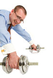 Handsome businessman exercising with dumbbells Royalty Free Stock Images