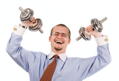 Handsome businessman exercising with dumbbells Stock Image