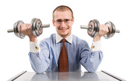 Handsome businessman exercising with dumbbells Stock Photography