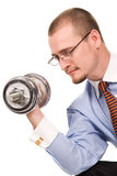 Handsome businessman exercising with dumbells Stock Photo