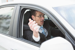 Handsome businessman experiencing road rage Royalty Free Stock Photography