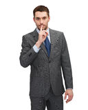 Handsome businessman with finger on his lips Royalty Free Stock Photo