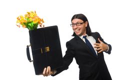 Handsome businessman with flower and brief case Stock Photo