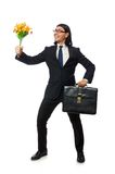 Handsome businessman with flower and brief case Stock Photography