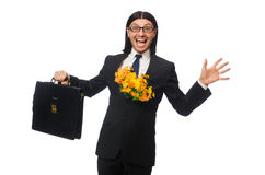 Handsome businessman with flower and brief case Royalty Free Stock Photos