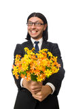 Handsome businessman with flower isolated on white Royalty Free Stock Photos