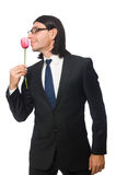 Handsome businessman with flower isolated on white Stock Image