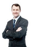 Handsome businessman with folded arms Stock Images