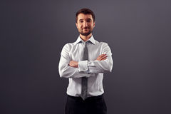 Handsome businessman with folded hands Royalty Free Stock Image