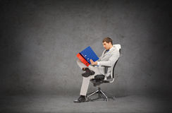Handsome businessman with folders sitting on chair Royalty Free Stock Images
