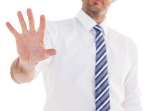 Handsome businessman gesturing with hand Royalty Free Stock Image