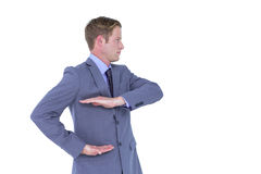 Handsome businessman gesturing with hands Royalty Free Stock Photos
