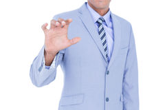 Handsome businessman gesturing with hands Stock Photography