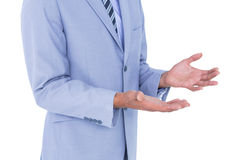 Handsome businessman gesturing with hands Stock Image