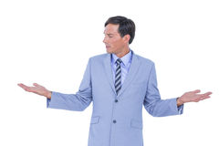 Handsome businessman gesturing with hands Royalty Free Stock Photography