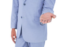 Handsome businessman gesturing with hands Stock Images