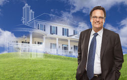 Handsome Businessman with Ghosted House Drawing Behind Stock Images