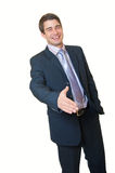 Handsome businessman is giving hand to say hallo Royalty Free Stock Photos