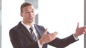 Handsome businessman giving presentation stock video footage