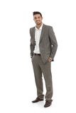 Handsome businessman in grey suit stock photography