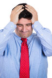 handsome businessman with hands on head with headache, stressed, frustrated Stock Photo