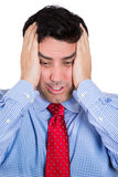 Handsome businessman with hands on head with headache, stressed, frustrated Royalty Free Stock Photography