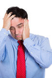 Handsome businessman with hands on head with headache, stressed, frustrated Royalty Free Stock Photo