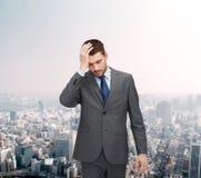 Handsome businessman having headache Royalty Free Stock Image