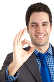 Handsome businessman having success. A man doing the sign of success Royalty Free Stock Image
