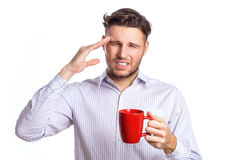 Handsome Businessman With A Headache Holding Red Cup royalty free stock image