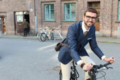 Handsome businessman heading to work by bike.  Stock Image