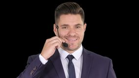 Handsome businessman with headset looking into camera and smiling, Alpha Channel. On Alpha Matte. Close up. Handsome businessman with headset looking into camera stock video footage
