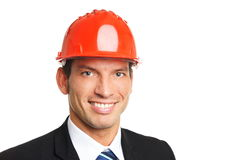 Handsome businessman in a helmet stock image