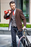 Handsome businessman and his bicycle Royalty Free Stock Photos