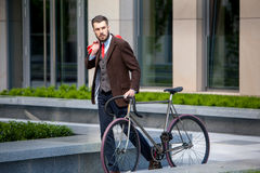 Handsome businessman and his bicycle Stock Images