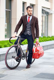 Handsome businessman and his bicycle Stock Photo