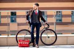 Handsome businessman and his bicycle Royalty Free Stock Images
