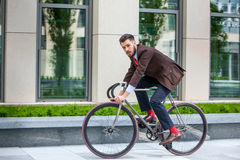 Handsome businessman and his bicycle Stock Photos