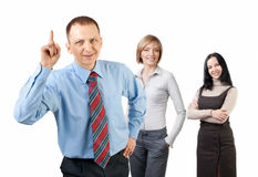 Handsome businessman and his colleagues Royalty Free Stock Photo