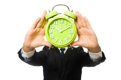 Handsome businessman holding alarm clock isolated Stock Photography