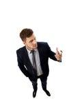 Handsome businessman holding big pencil. Stock Image