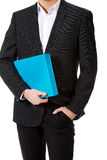 Handsome businessman holding a binder. Happy handsome businessman holding a binder Royalty Free Stock Photos