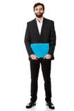 Handsome businessman holding a binder. Royalty Free Stock Images