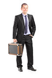 Handsome businessman holding a briefcase Stock Photos