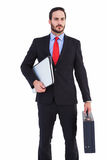 Handsome businessman holding briefcase and laptop Stock Images