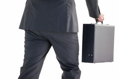 Handsome businessman holding briefcase walking Stock Photography