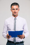 Handsome businessman holding clipboard Royalty Free Stock Photography