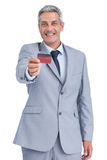 Handsome businessman holding credit card Royalty Free Stock Photos