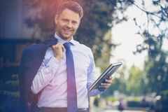 Handsome businessman holding dairy and blazer Stock Images